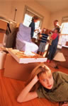 woman_packing_boxes-moving_house-unpacking-declutter-good_housekeeping_uk_590_590_90
