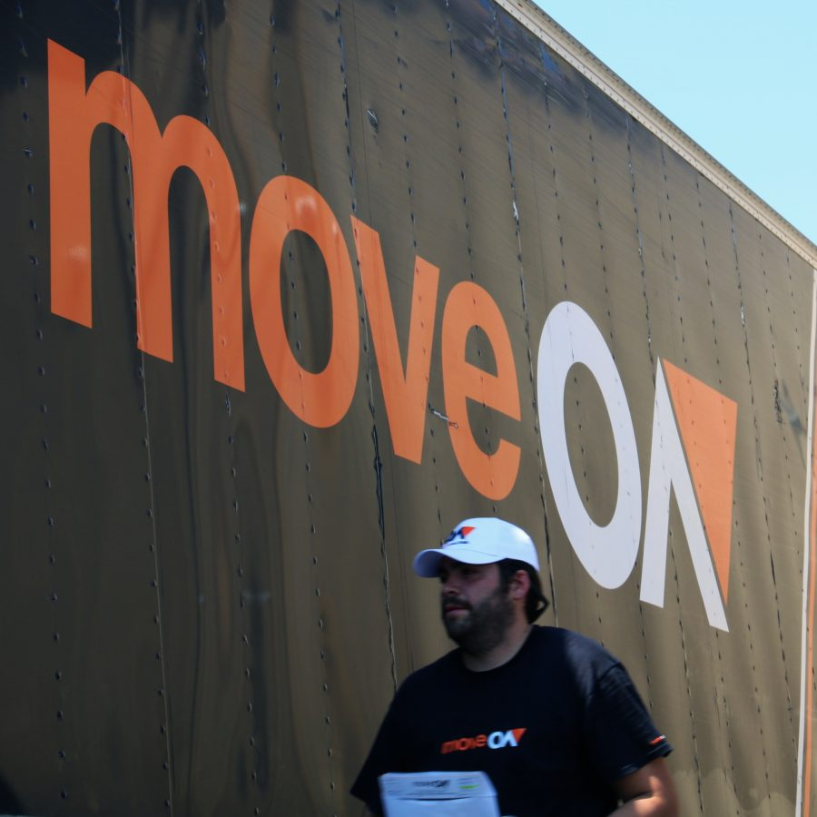 moving-men-walking-alongside-truck.jpg