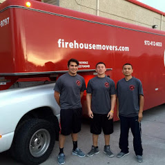 Firehouse Movers in front of moving trailer.jpg